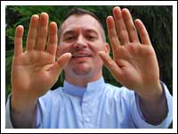 Photo of Reiki Master Brian Brunius sending Reiki through his hands to the viewer of the photo