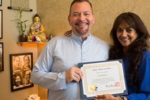 Anu Butani of Rockville Centre Long Island receives her Reiki Master certificate from Brian Brunius of the NYC Reiki Center