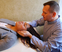 Brian Brunius treating with Reiki