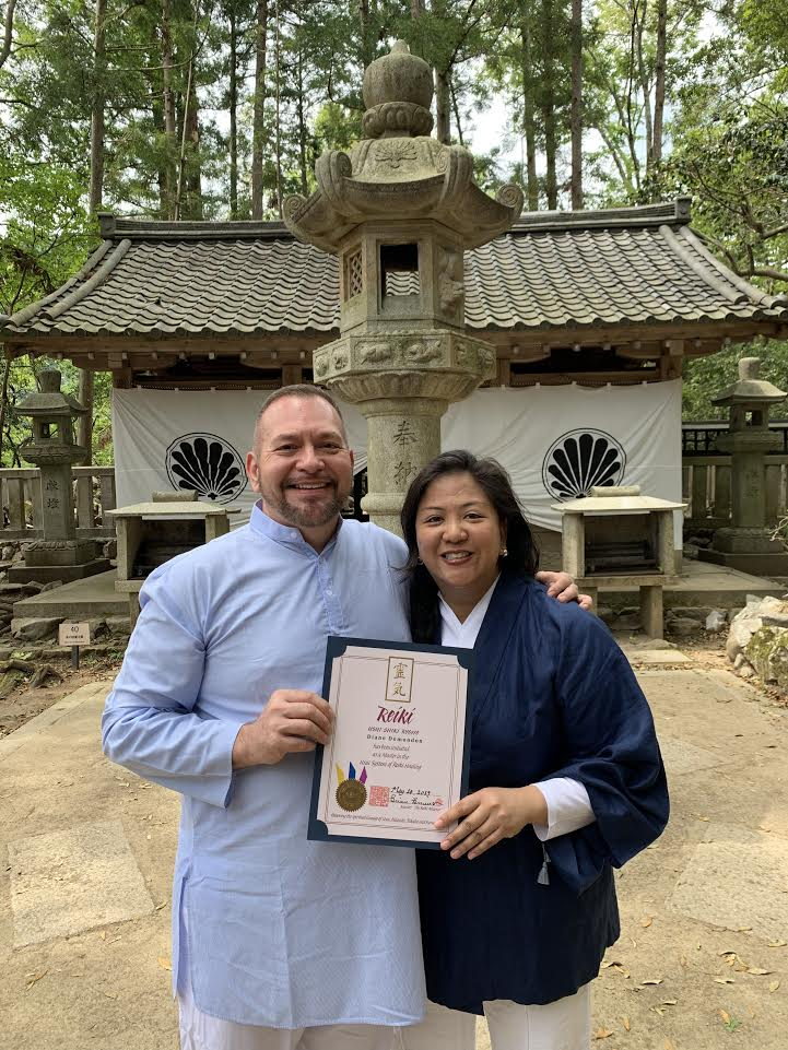 Photo of Brian Brunius presenting Diane Domondon her Reiki Master Certificate, May 10, 2019 on Mount Kurama, Japan