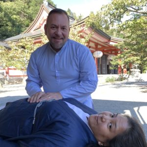 Photo of Brian Brunius and Diane Domondon in front of the Kurama-dera temple atop Mount Kurama in Kyoto, Japan