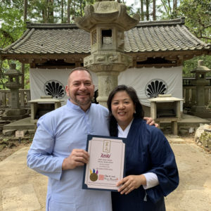 Photo of Brian Brunius and Diane Domondon in front of the Okunoin temple, considered to be the most sacred spot on Mount Kurama in Kyoto, Japan