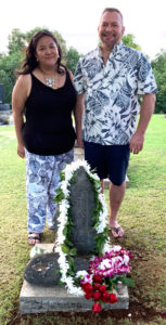 Photo of Diane Domondon and Brian Brunius standing at the grave and memorial stone of Reiki Grandmaster Phyllis Lei Furumoto in Kauai, Hawaii.